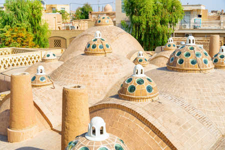 Amazing view of domes with convex glasses on scenic roof of Sultan Amir Ahmad Bathhouse in Kashan, Iran. Traditional Iranian public bathhouse. Awesome Persian architecture.