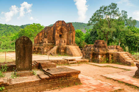 Amazing view of stone slab with Sanskrit inscriptions and ruins of My Son Sanctuary, Da Nang, Vietnam. My Son is a complex of partially ruined ancient Hindu temples constructed by the kings of Champa. Zdjęcie Seryjne