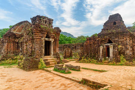 Awesome view of red brick temples of My Son Sanctuary in Da Nang (Danang), Vietnam. My Son is a complex of partially ruined ancient Hindu temples constructed by the kings of Champa. Zdjęcie Seryjne