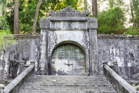 Locked bronze door to the burial site of Emperor Minh Mang in the royal tomb at Hue, Vietnam. Hue is a popular tourist destination of Asia.