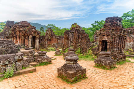 Beautiful view of My Son Sanctuary among green woods in Da Nang (Danang), Vietnam. My Son is a complex of partially ruined ancient Hindu temples constructed by the kings of Champa.
