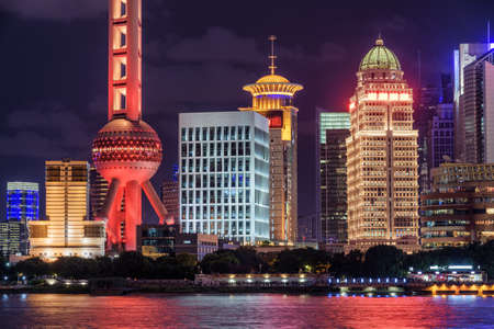 Amazing night view of colorful glowing modern buildings at the Pudong New District (Lujiazui) in downtown of Shanghai, China. Beautiful cityscape. Shanghai is a popular tourist destination of Asia.