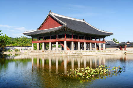 Scenic view of Gyeonghoeru Pavilion and Gyeongbokgung Palace, Seoul, South Korea. The Royal Banquet Hall reflected in water of rectangular lake. Beautiful buildings of traditional Korean architecture.
