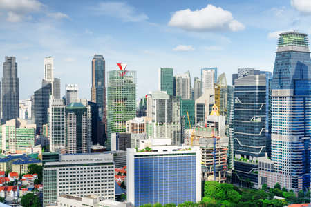 Scenic view of skyscrapers and other modern buildings in downtown of Singapore on blue sky background. Beautiful summer cityscape. Singapore is a popular tourist destination of Asia. Zdjęcie Seryjne - 125871955