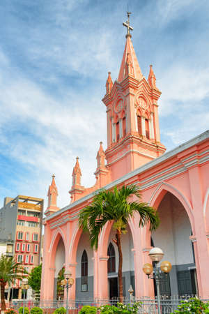 Amazing view of Da Nang Cathedral on blue sky background at downtown of Danang, Vietnam. The Pink Catholic Church is a popular tourist attraction of Asia.