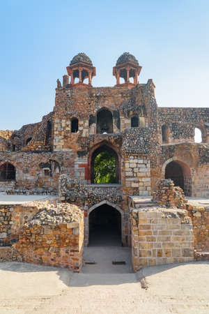Amazing inside view of Humayun Gate of Purana Qila on blue sky background in Delhi, India. South Gate of the Old Fort. Delhi is a popular tourist destination of South Asia. Zdjęcie Seryjne - 125872097