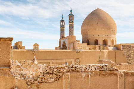 Scenic view of Agha Bozorg Mosque on blue sky background in Kashan, Iran. Amazing Islamic architecture. The historical mosque and madrasa is a popular tourist attraction of the Middle East.
