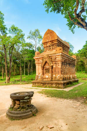 Amazing view of stone yoni (pindika) and red brick temple of My Son Sanctuary in Da Nang, Vietnam. My Son is a complex of partially ruined ancient Hindu temples constructed by the kings of Champa.