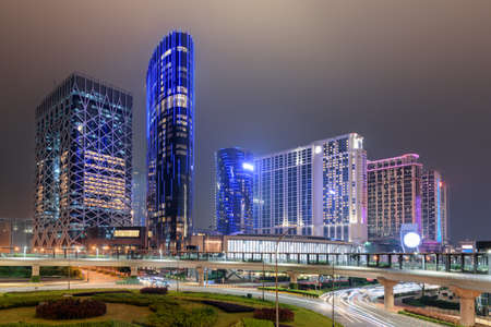 Wonderful night view of modern buildings in Cotai of Macau. Beautiful cityscape. Cotai is a new gambling and tourism area with casinos and shopping malls. Zdjęcie Seryjne - 125873161