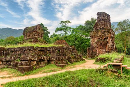 Awesome view of My Son Sanctuary among green woods in Da Nang (Danang), Vietnam. My Son is a complex of partially ruined ancient Hindu temples constructed by the kings of Champa.