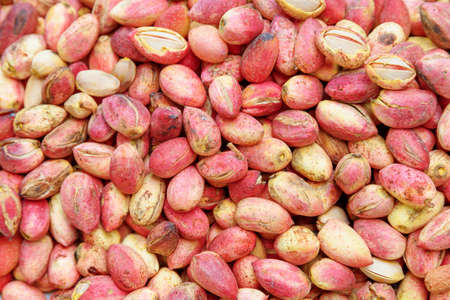 Closeup view of fresh pink pistachios. Healthy eco food. Product of organic farming. Freshly harvested pistachio nuts. Zdjęcie Seryjne - 125873541