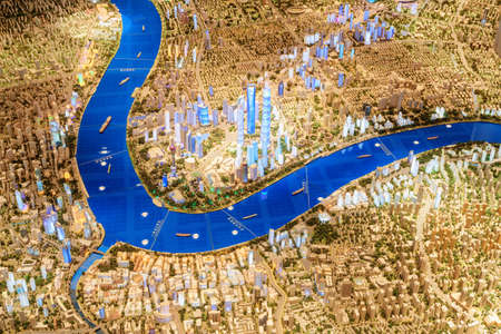 Shanghai, China - October 3, 2017: Top view of part of scale model of the city including the Pudong New District (Lujiazui) and the Bund (Waitan). The Shanghai Urban Planning Exhibition Center.