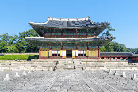 Main view of Injeongjeon Hall at Changdeokgung Palace on blue sky background in Seoul, South Korea. Scenic pavilion of traditional Korean architecture. Seoul is a popular tourist destination of Asia.