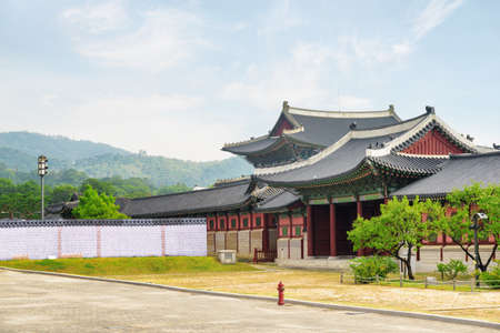 Beautiful view of Gyeongbokgung Palace at Seoul in South Korea. Scenic buildings of traditional Korean architecture. Seoul is a popular tourist destination of Asia.