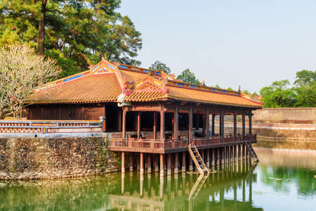 Amazing view of Xung Khiem Pavilion by Luu Khiem Lake at the Tu Duc Royal Tomb in Hue, Vietnam. Hue is a popular tourist destination of Asia.