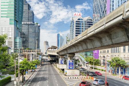 Bangkok, Thailand - 14 October, 2018: Beautiful view of Sathon Road and Surasak station of BTS Silom Line. Amazing sunny cityscape. Bangkok is a popular tourist destination of Asia.