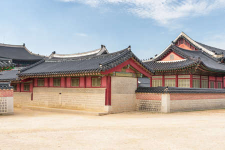 Gyeongbokgung Palace at Seoul in South Korea. Scenic buildings of traditional Korean architecture are visible on blue sky background. Seoul is a popular tourist destination of Asia.