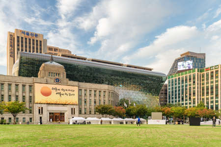Seoul, South Korea - October 12, 2017: Scenic view of the City Hall and public green space of Seoul Plaza. The City Hall is a governmental building and a popular tourist attraction of Asia.