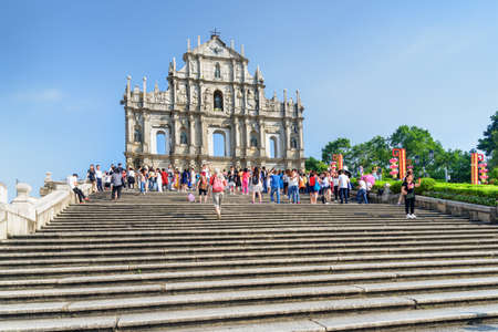 Macau - October 18, 2017: Scenic view of the Ruins of St. Pauls on blue sky background. Macau is a popular tourist destination of Asia and leading casino market of the world.