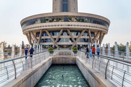 Tehran, Iran - 19 October, 2018: Scenic view of fountains and entrance to Milad Tower. The tower is a popular tourist attraction of the Middle East.