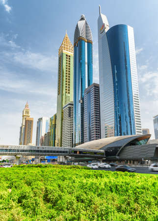 Dubai, United Arab Emirates - 2 November, 2018: Awesome view of skyscrapers at downtown on blue sky background. Financial Centre Station of the Dubai Metro. Amazing cityscape on sunny day.