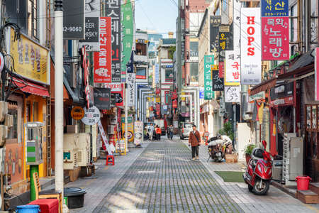 Busan, South Korea - October 7, 2017: Amazing morning view of narrow street. Gwangbokro Cultural and Fashion Street. Gwangbokro is a popular tourist destination of Asia.