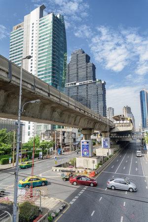 Bangkok, Thailand - 14 October, 2018: Scenic view of Sathon Road and Surasak station of BTS Silom Line. Amazing cityscape. Bangkok is a popular tourist destination of Asia.