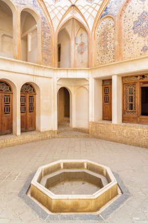 Kashan, Iran - 21 October, 2018: Amazing small traditional Iranian courtyard of Tabatabaei Historical House. Gorgeous Persian architecture. Kashan is a popular tourist destination of the Middle East. Publikacyjne