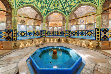 Kashan, Iran - 21 October, 2018: Beautiful view of octagonal dressing hall (sarbineh) with pool in the middle at Sultan Amir Ahmad Bathhouse. Cloakroom of traditional Persian public bathhouse. Publikacyjne
