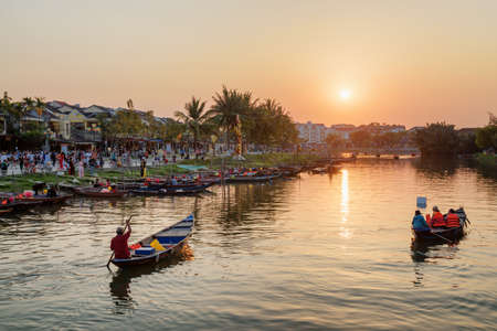 Hoi An (Hoian), Vietnam - April 11, 2018: Beautiful view of boats on the Thu Bon River at sunset.