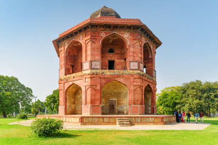 Delhi, India - 6 November, 2018: Awesome view of Sher Mandal at Purana Qila on blue sky background. Red sandstone octagonal tower was used as Humayuns private observatory and library in the Old Fort. Publikacyjne