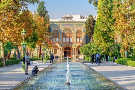 Tehran, Iran - 19 October, 2018: Tourists taking pictures of scenic fountains and walking along garden of the Golestan Palace. The Golestan Palace is a popular tourist attraction of the Middle East. Zdjęcie Seryjne - 125865865