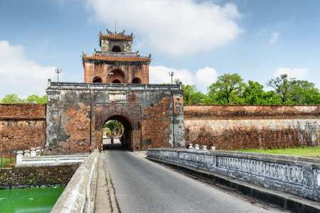 Way to the Imperial City with the Purple Forbidden City through the Ngan Gate in fortress wall of the Citadel in Hue, Vietnam. Hue is a popular tourist destination of Asia. Publikacyjne