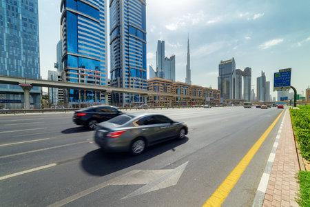 Dubai, United Arab Emirates - 2 November, 2018: Wonderful view of Sheikh Zayed Road at downtown. The iconic Burj Khalifa Tower is visible on blue sky background. Day traffic of Dubai. Scenic cityscape