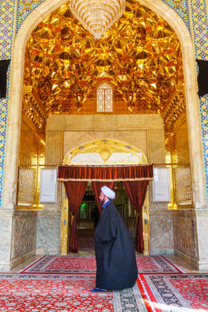 Shiraz, Iran - 29 October, 2018: Awesome view of entrance to the Shah Cheragh Mosque and Mausoleum. Ceiling decorated with gilded tiles. Persian interior of the Muslim place. Islamic architecture. Publikacyjne