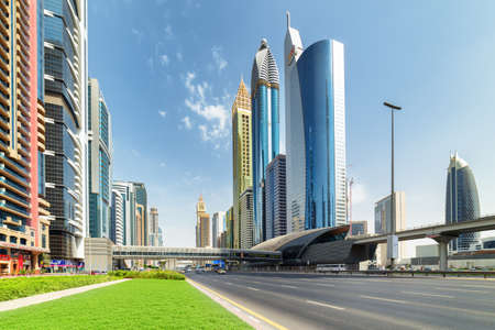 Dubai, United Arab Emirates - 2 November, 2018: Amazing view of Sheikh Zayed Road and Financial Centre Station of the Dubai Metro. Scenic skyscrapers are visible on blue sky background. Zdjęcie Seryjne - 125865878