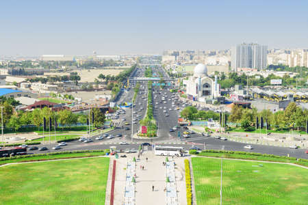 Tehran, Iran - 19 October, 2018: Scenic aerial view of Lashkari Expressway. Day traffic. Amazing cityscape on sunny day. Tehran is a popular tourist destination of the Middle East.