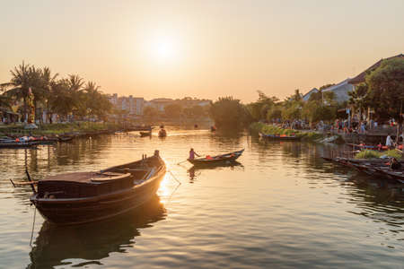 Hoi An (Hoian), Vietnam - April 11, 2018: Wonderful view of boats on the Thu Bon River at sunset.