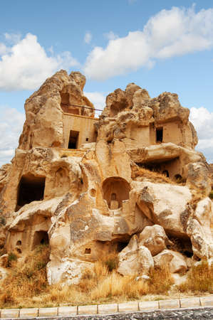 Awesome view of ruins of ancient cave house in Goreme at Cappadocia, Turkey. Amazing rock dwelling. Cappadocia is a popular tourist destination of Turkey.