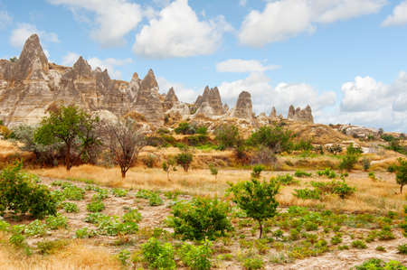 Awesome landscape of Goreme National Park in Cappadocia, Turkey. Amazing view of scenic valley and Fairy Chimney Rock Formations. Cappadocia is a popular tourist destination of Turkey.