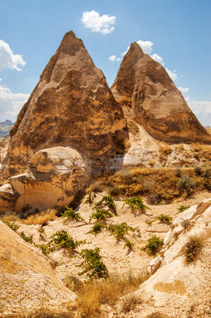 Scenic view of Fairy Chimney Rock Formations in Goreme National Park at Cappadocia, Turkey. Cappadocia is a popular tourist destination of Turkey.