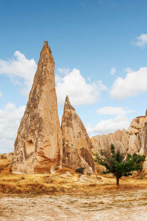 Awesome view of Fairy Chimney Rock Formations in Goreme National Park at Cappadocia, Turkey. Amazing landscape. Cappadocia is a popular tourist destination of Turkey.