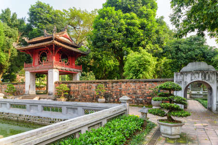 Awesome view of the Khue Van pavilion among green trees from the third courtyard of the Temple of Literature in Hanoi, Vietnam. The Temple of Confucius is a popular tourist destination of Asia. Zdjęcie Seryjne