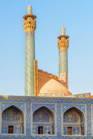Gorgeous view of awesome minarets covered with colorful mosaic tiles at the Shah Mosque (Imam Mosque) in Isfahan, Iran. Wonderful Persian exterior of the Muslim place. Amazing Islamic architecture.