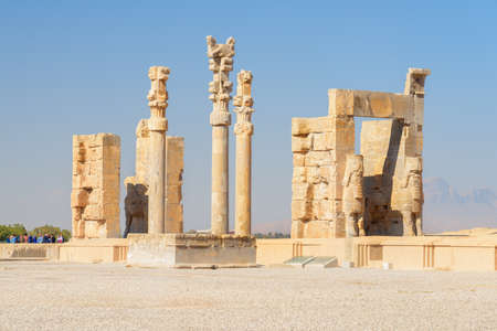 Awesome ruins of the Gate of All Nations on blue sky background in Persepolis, Iran. Ancient Persian city. Persepolis is a popular tourist destination of the Middle East.