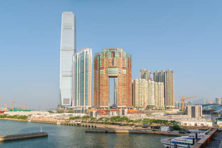 Awesome view of skyscraper and other modern buildings in West Kowloon of Hong Kong. Amazing cityscape on sunny day. Hong Kong is a popular tourist destination of Asia.