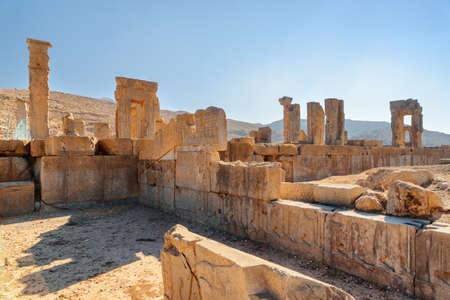 Awesome view of scenic ruins on blue sky background in Persepolis, Iran. Ancient Persian city. Persepolis is a popular tourist destination of the Middle East.