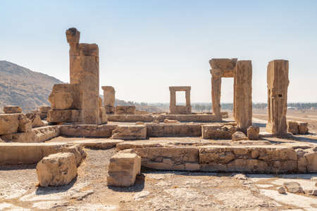 Scenic ruins of the Hadish Palace (the Palace of Xerxes) on blue sky background in Persepolis, Iran. Ancient Persian city. Persepolis is a popular tourist destination of the Middle East.