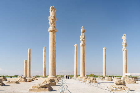 Scenic view of columns of the Apadana Palace on blue sky background in Persepolis, Iran. The hypostyle hall of ancient Persian city. Persepolis is a popular tourist destination of the Middle East. Stok Fotoğraf