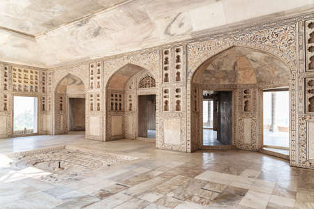 Agra, India - 9 November, 2018: Awesome view of the Diwan-i-Khas (Hall of Private Audiences) at the Agra Fort. The marble chamber is a popular tourist attraction of South Asia. Mughal architecture.